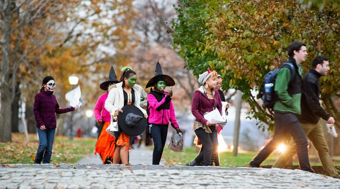 Children with escorts walk down Campus Road during the annual Halloween Trust Treat.  PHOTO: BY NANCY FORD