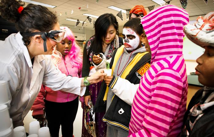 Chemistry major Laura Rivera '16, helps Trick-or-Treaters make slime in the Taylor Science Center. PHOTO: BY NANCY FORD