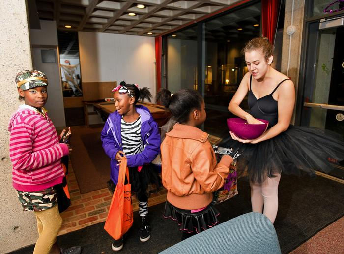 Leah Berryhill '13 hands out candy in McIntosh Hall.  PHOTO: BY NANCY FORD