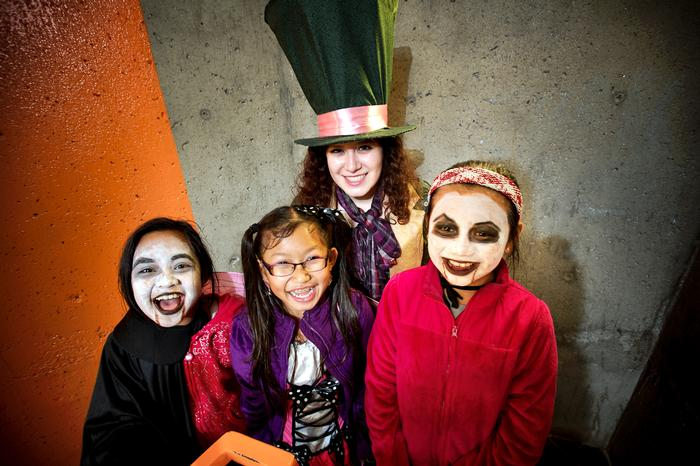 Madhatter Melissa Segura '14 poses with her trick-or-treaters in Babbitt. PHOTO: BY NANCY L. FORD