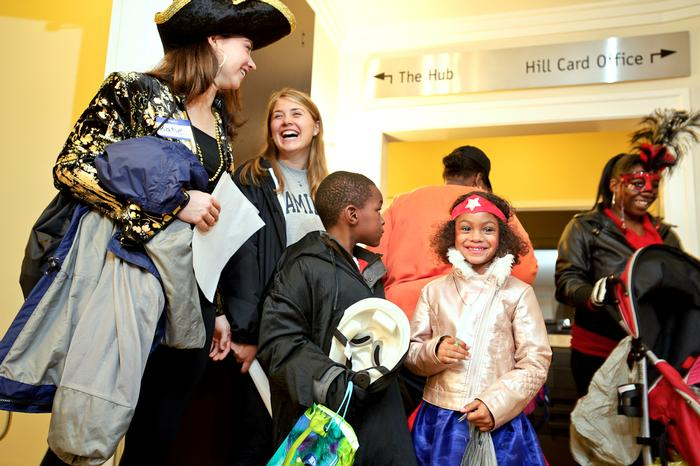 Katie Veasey '17 and Charlotte Chandler '17 wait their turn with their new friends, Nashawn Harvey, 6, and Amiuah Evans, 6. PHOTO: BY NANCY L. FORD