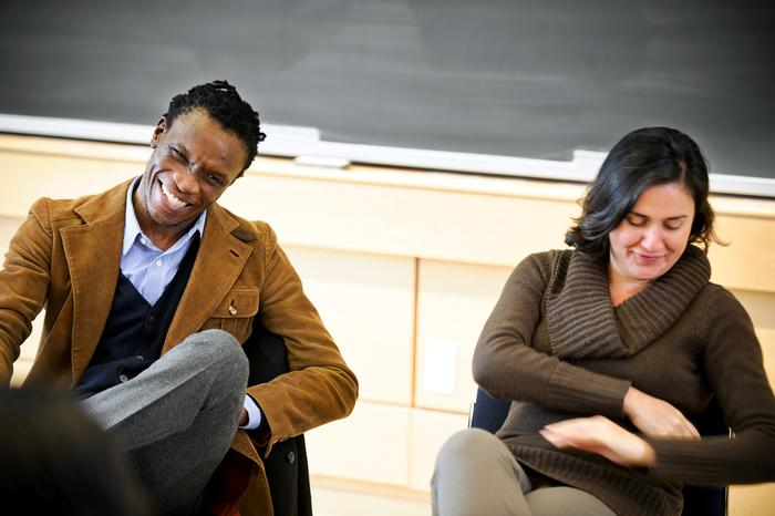 Ishion Hutchinson and Kamila Shamsie '94 laugh during the panel discussion on Saturday. PHOTO: NANCY L. FORD