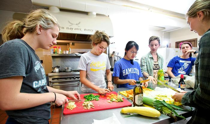 Students prepare dinner with food they harvested earlier in the day. PHOTO: NANCY L. FORD