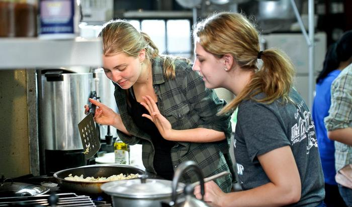 eXploration Adventure group students cook dinner together at Westminster Church. PHOTO: NANCY L. FORD