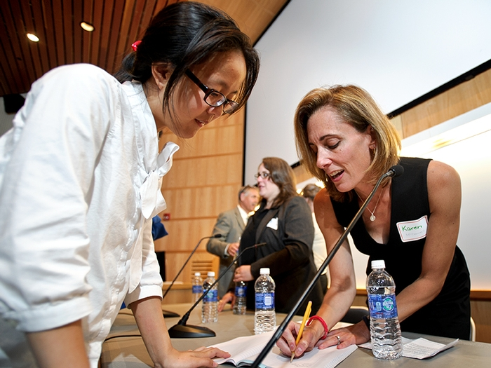 Wenlu Weng '16 talks to Karen McDonnell '91 after the panel.