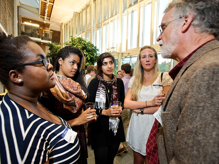 Christopher Wilkinson '68 talks with students during the Senior Gift Kickoff Reception.