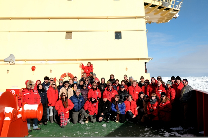 Group picture on the bow of the ship, including scientists, crew, and the captain in his Big Red Parka with large fur hood.