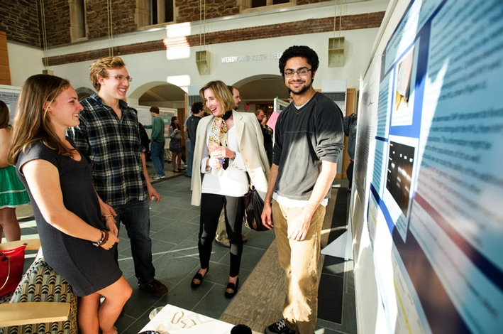 Rachel Green '14, Xander Kerman '14, Patricia Gregory P'14 and Ravi Jariwala '13 chat during the poster session. (PHOTO BY NANCY L. FORD)