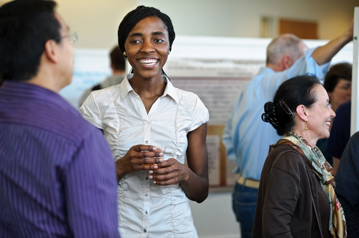 Pauline Wafula '13 talks with her Levitt summer research advisor Professor of Economics Stephen Wu.
