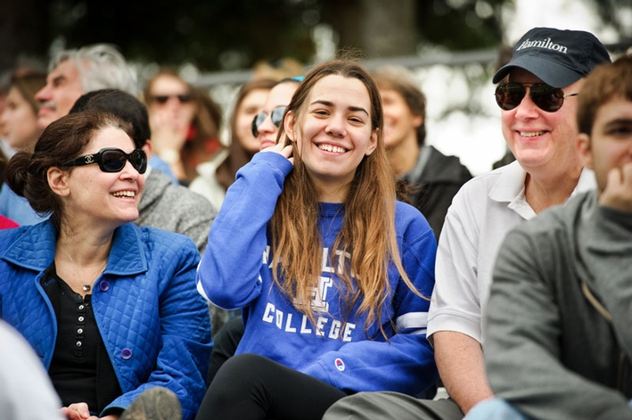 Emily Bonacum '16 enjoys the game with her parents, Madeline and John. (PHOTO BY NANCY L. FORD)