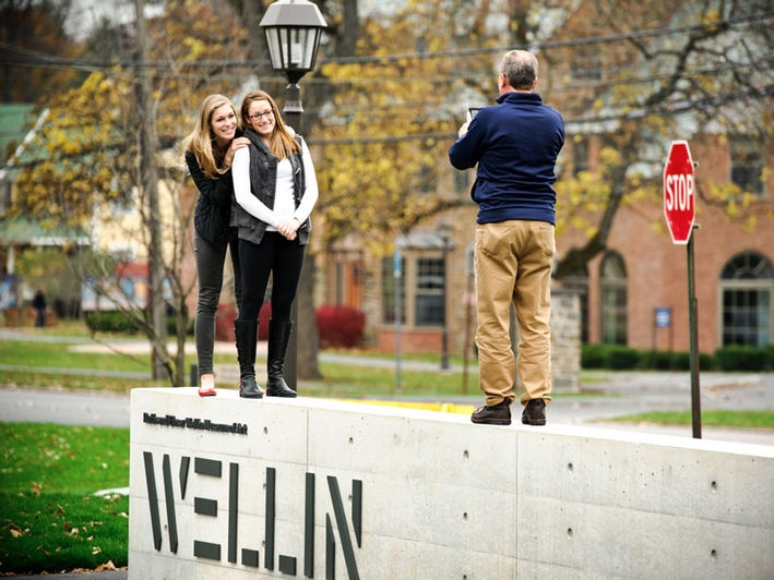 Dani Feigin '13 and Olivia Pimm '14, get their photo taken by Olivia's dad, Tom Pimm in front of the Wellin Museum of Art.  (PHOTO BY NANCY L. FORD)