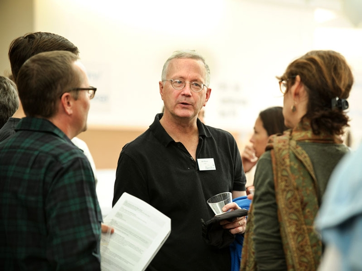 Professor Bill Pfitsch chats with parents during tea. (PHOTO BY NANCY L. FORD)