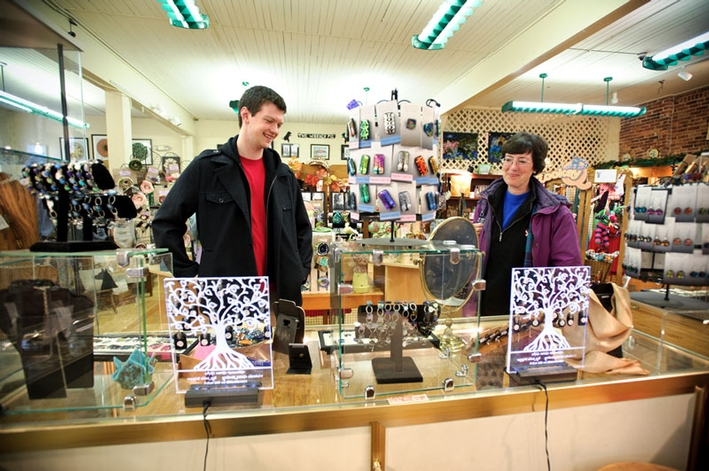 Andrew Rippel '14 shops with his mom, Polly Handcock, in the Artisans' Corner in Clinton. (PHOTO BY NANCY L. FORD)