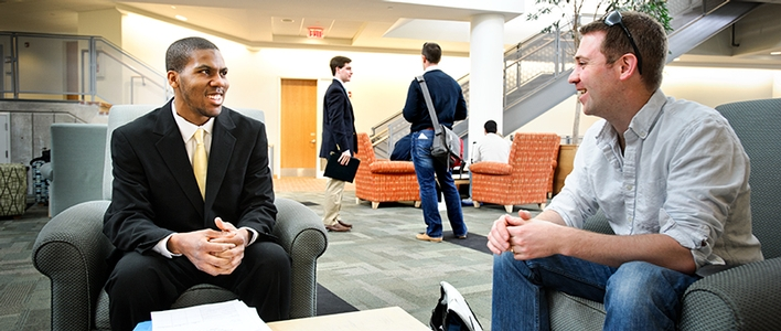 Leonard Collins &apos;15, left, is coached by Mark Kasdorf &apos;06, during an annual Pitch competition mentoring session.<br />Photo: Nancy L. Ford