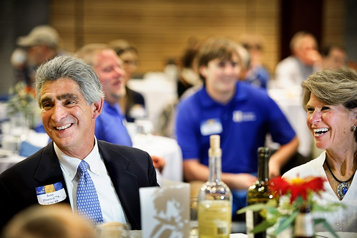 Jerry Pitarressi &apos;71, P&apos;08, P&apos;10, left and his wife Marie, laugh at remarks during the annual Football Banquet.<br />Photo: Nancy L. Ford