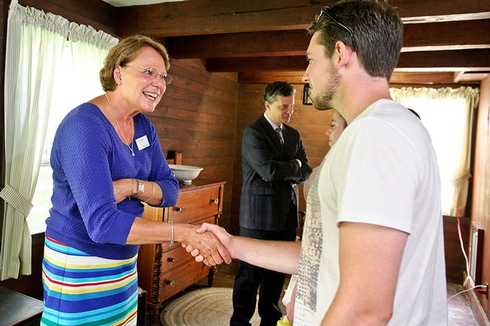 Dan Horgan &apos;18 is greeted by Dean of Students Nancy Thompson in Kirkland Cottage during matriculation.<br />Photo: Nancy L. Ford