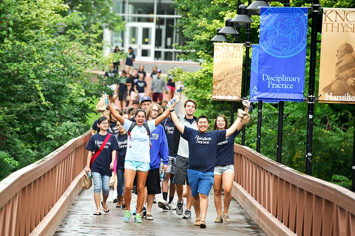 Members of the Class of 2018 cross the bridge on Martin&apos;s Way as they make their way in to the community to volunteer for Hamilton Serves.<br />Photo: Rebecca L. Sheets