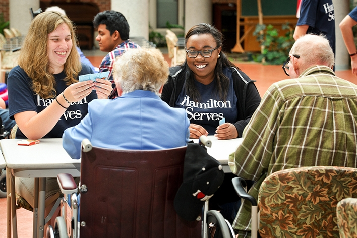 Maria Barnard &apos;18 and Eseosa Asiruwa &apos;18 play cards with Eva and Larry King at the Masonic Home.<br />Photo: Nancy L. Ford