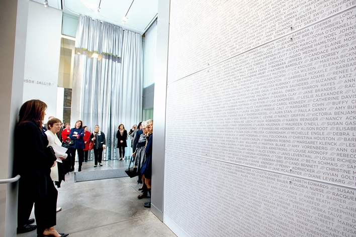 President Stewart shows alumni the wall of names of all matriculated Kirkland women inside The Kennedy Center.<br />Photo: Nancy L. Ford