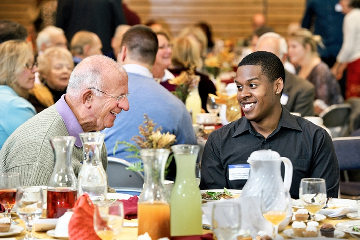 Art Massolo &apos;64 chats with Adrian Marcano &apos;16 during the Comstock Luncheon.<br />Photo: Nancy L. Ford