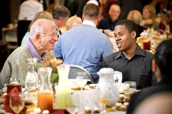 Art Massolo &apos;64 chats with Adrian Marcano &apos;16 during the Helen and Doane Comstock &apos;27 Memorial Luncheon.<br />Photo: Nancy L. Ford