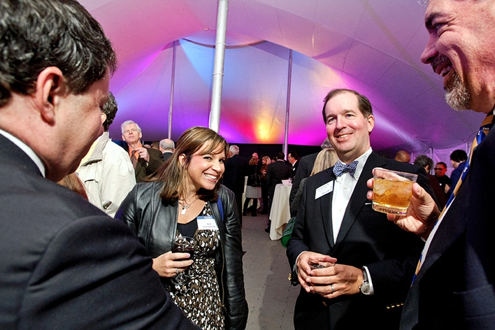 Amy Greenan &apos;04 and Paul Reichert &apos;90, and other guest mingle during the on Fallcoming Weekend Awards Dinner.<br />Photo: Nancy L. Ford