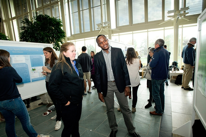 Leonard Kilekwang &apos;16 talks about his summer science research during a poster session in the Taylor Science Center.<br />Photo: Rebecca L. Sheets