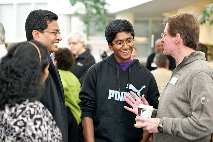 Chandrika and Nad Mahendraraj, along with son Kuhan &apos;18, talk with Associate Professor of Biology Mike McCormick.<br />Photo: Nancy L. Ford