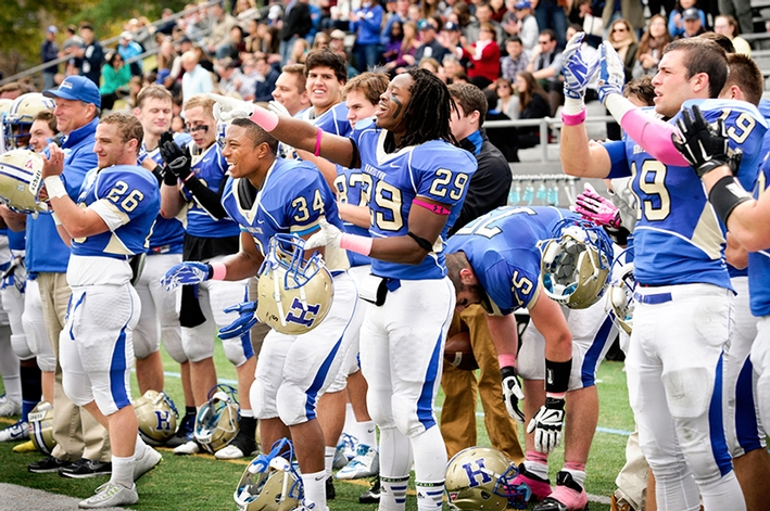 Hamilton football players cheer on their team.<br />Photo: Rebecca L. Sheets