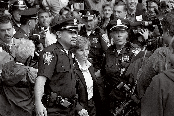 Police escort Mary Bonauto through the crowd on May 17, 2004, the first day same-sex couples could marry in Massachusetts.