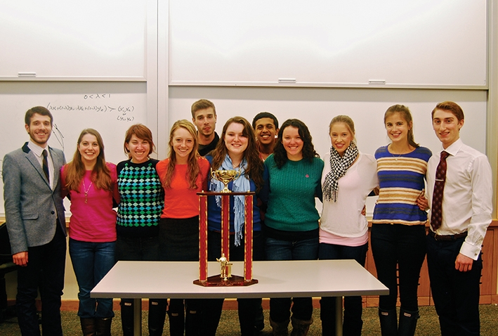 The verdict is in — Hamilton's mock trial team with the first-place trophy earned at Cornell's Big Red Invitational