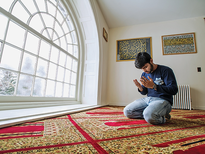Shakil Hossain '14, president of the Muslim Student Association, in the prayer room located on the third floor of the Chapel.