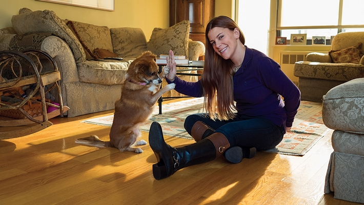 Pawsibilities New York founder Erica Lieberman Wittenberg '04 gets a high-five from pal Nadia.