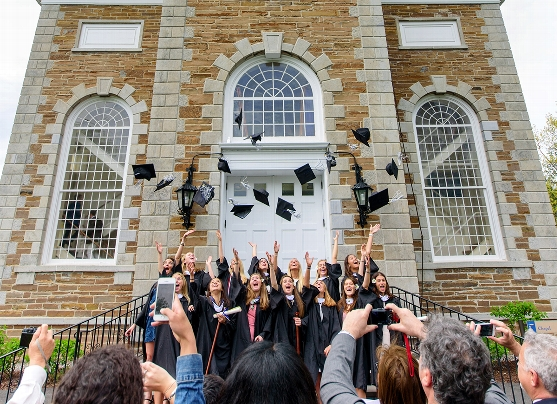 A group of graduates celebrates on the Chapel steps.<br />Photo: Nancy L. Ford