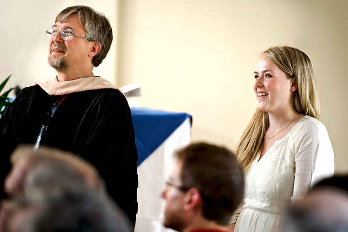 Riley Stepnick &apos;12, with Professor of Music Sam Pellman, listens as the College Choir debuts the song she wrote for Hamilton.<br />Photo: Nancy L. Ford