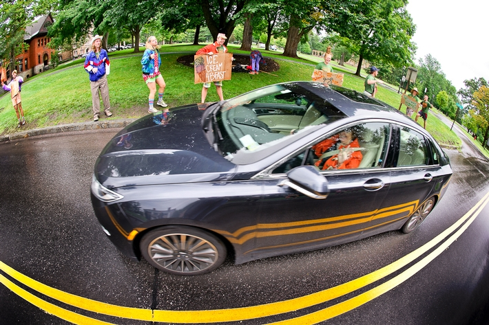 President Joan Hinde Stewart drives by the enthusiastic greeters. <br />Photo: Nancy L. Ford
