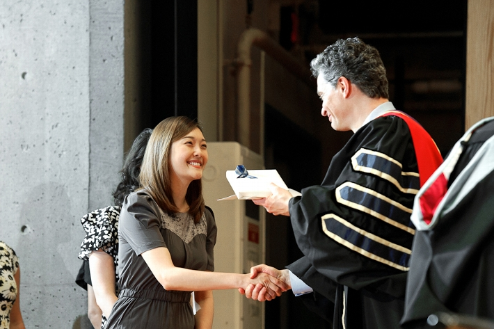 Crystal Kim &apos;15 accepts an award from Dean of Faculty Patrick Reynolds.<br />Photo: Nancy L. Ford