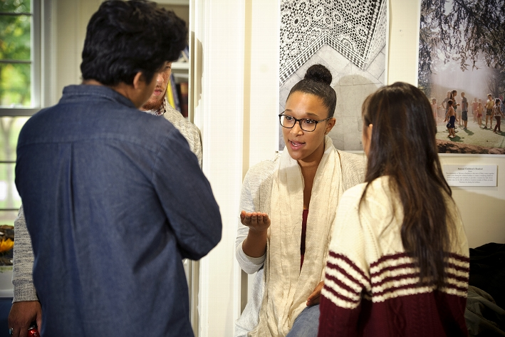 Denise Ghartey &apos;12, center, talks with students at the Days-Massolo Center.<br />Photo: Nancy L. Ford