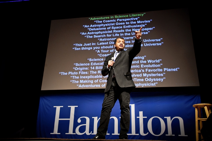 Neil deGrasse Tyson on stage in the Field House.<br />Photo: Nancy L. Ford