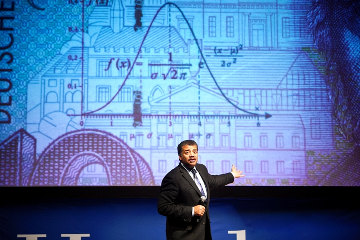 Tyson notes the inclusion of the bell curve on German currency.<br />Photo: Nancy L. Ford