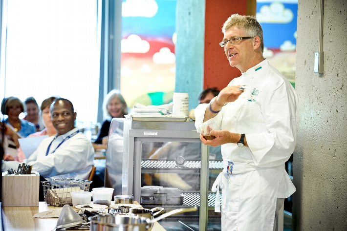 Stephen Durfee &apos;85, professor of baking and pastry at the Culinary Institute of America, gives a chocolate cooking demo.<br />Photo: Nancy L. Ford