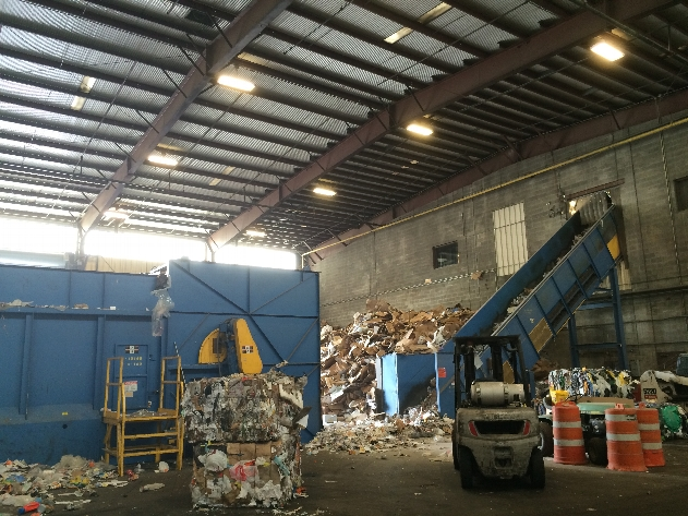Recyclables are placed on conveyor belts to enter the recycling facility.
