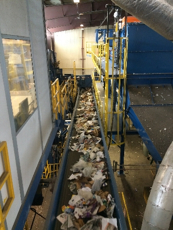 After paper is segregated from plastic, glass and metal, sorters separate any leftover trash once more.