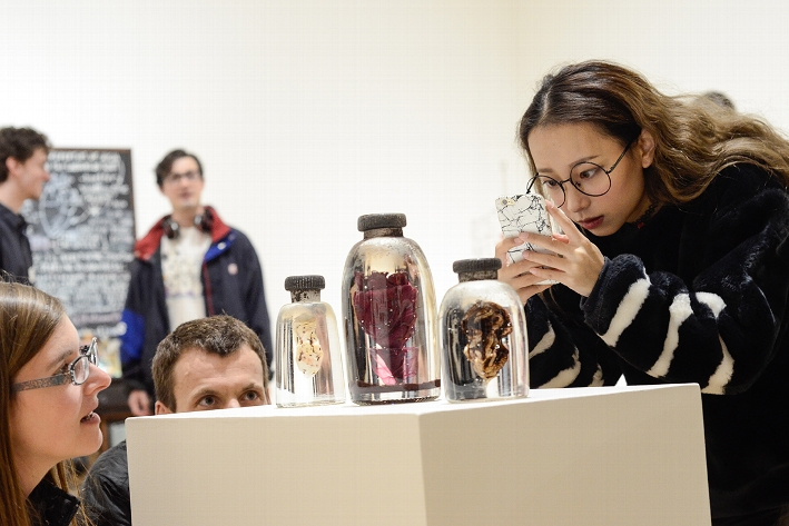 Hamilton Community members take a close look at objects on view in the Wellin Museum exhibition  &lt;em&gt;Renee Stout: Tales of the Conjure Woman&lt;/em&gt;<br />Photo: Heather Ainsworth