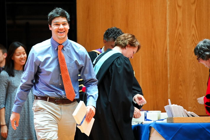 Eric Lintala &apos;16 walks across the stage after accepting a prize. <br />Photo: Nancy L. Ford