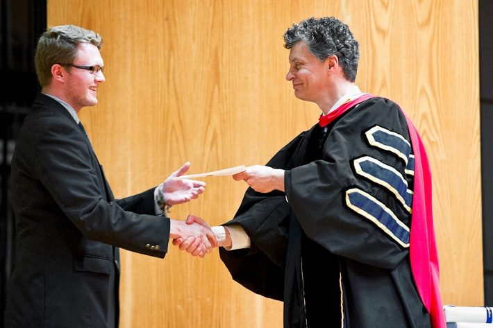Bryan Ferguson &apos;17 accepts an award from Dean of Faculty Patrick Reynolds.<br />Photo: Nancy L. Ford
