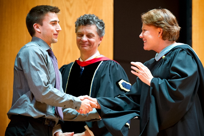 Alex Mitko &apos;16 receives congratulations from Dean of Students Nancy Thompson and Dean of Faculty Patrick Reynolds.<br />Photo: Nancy L. Ford