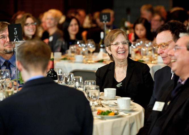 President Joan Hinde Stewart laughs at remarks by John Hadity during the Volunteer Weekend Recognition Dinner in Tolles Pavillion<br />Photo: Nancy L. Ford