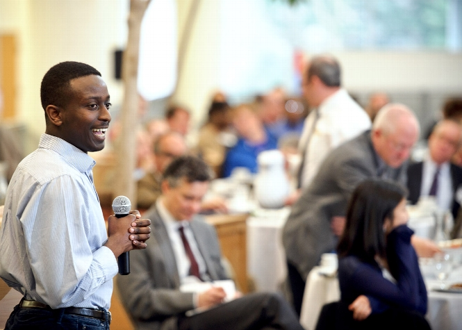 Anthony Jackson &apos;15 speaks to guests at the Volunteer Weekend Welcome Lunch in Kirner-Johnson <br />Photo: Nancy L. Ford