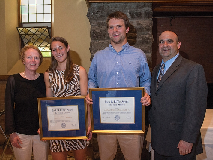Riffle Award winners Alex Rimmer '13 and Mike MacDonald '13 flanked by Colette Gilligan, head coach of women's soccer, and Andrew Cohen, the Mary Jayne Comey and Mac Bristol '43 Head Football Coach.